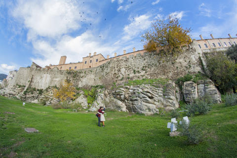 Boy and girl under the medieval fortress, beautiful sky and birds フォト