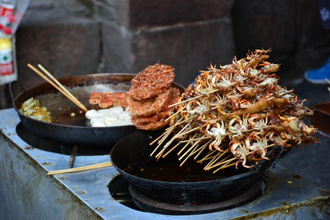 Shot of exotic street food in China Photo