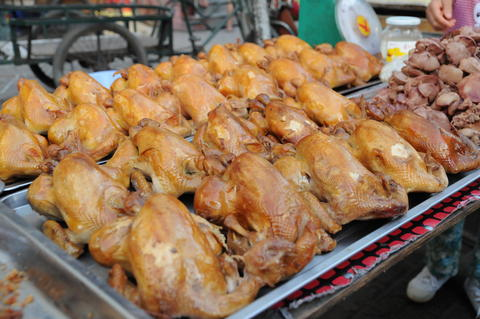 Shot of exotic street food in China フォト