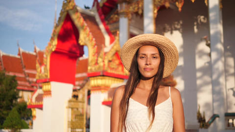 Beautiful Smiling Young Mixed Race Tourist Woman in Straw Hat with Traditional Footage