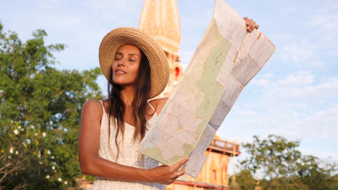 Young Mixed Race Tourist Girl in Straw Hat Holding Map and Exploring Traditional Footage