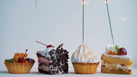 Different cupcakes with sparklers. Idea for holidays, birthdays, anniversaries Footage