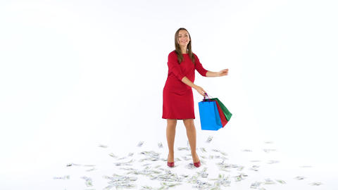 Dollar bills falling on shopping woman with multicolored shopping bags and crazy Footage