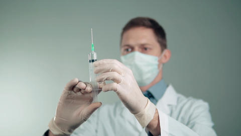 the doctor picks up the medicine in the injection syringe. slow motion Footage