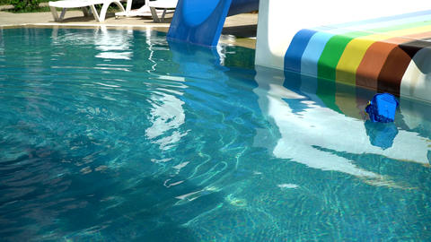 Pool with slides on the background of sun loungers. the water floats a kid's Footage