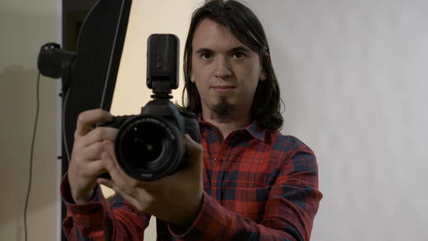 Young photography student with dark hair on his first day at work in a Footage