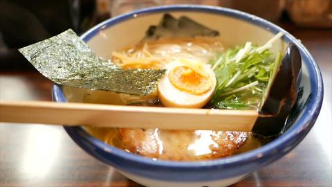 bowl of hot ramen or noodles soup in japan Footage