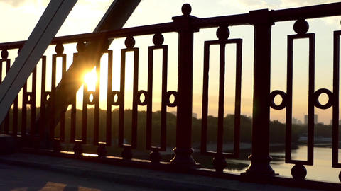 Pan Shot of a Splendid Sunset on a River Bridge in Summer in Slow Motion Footage