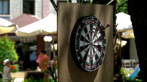 Darts on the background of sun loungers Footage