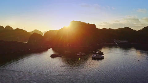 Drone Shows Hilly Island Silhouettes and Bay Water at Sunrise Footage