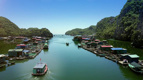 Drone Shows Ship Sailing along Traditional Floating Village Footage