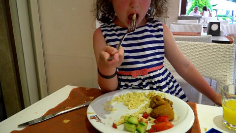 Little Girl Eats In Cafe 0