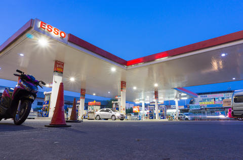 Esso gas station at early morning time フォト