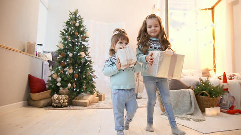 Two sisters in the Christmas run to give gifts to their parents Footage