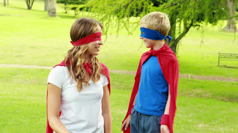Mother and son pretending to be superhero Live Action
