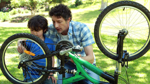 Father and son fixing bike Footage
