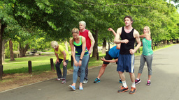 Athletic group stretching and running Footage
