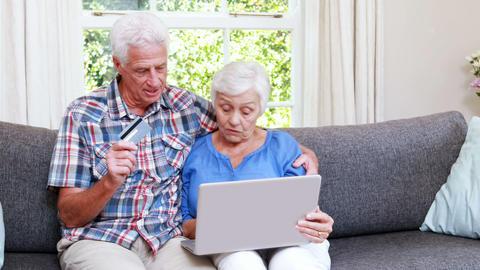 Senior couple shopping online Footage