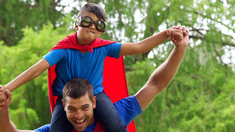 Father giving piggy back to son Footage