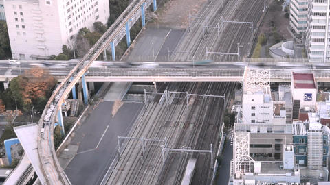 High angle motion timelapse of commuter traffic over the railroads and Tokyo Met Footage