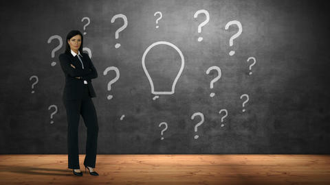 Businesswoman standing against question marks and bulb Footage