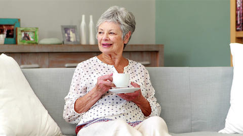 Senior woman drinking coffee Footage