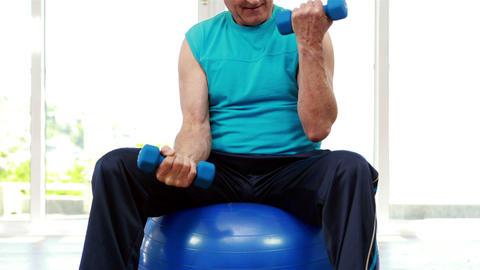 Senior man sitting on exercise ball Live Action
