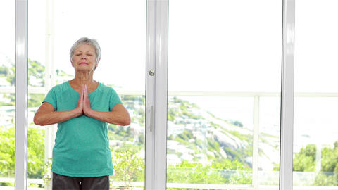 Senior woman practicing yoga Footage