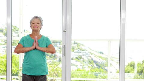 Senior woman practicing yoga Footage