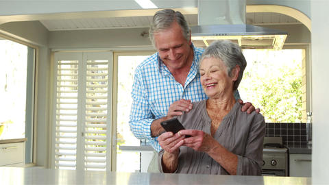 Senior couple using smart phone Footage