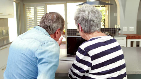 Senior couple using a laptop Footage