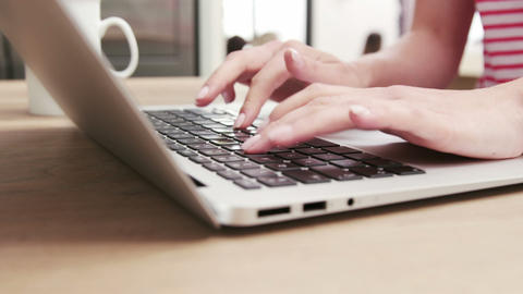 Close up view of a woman typing on her laptop Footage