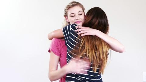 Female friends hugging Footage