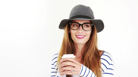 Pretty brunette with eyeglasses and hat drinking coffee Footage