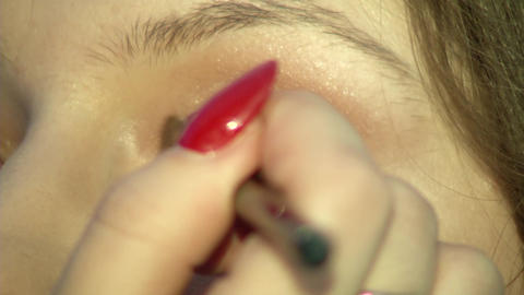 Eye of the girl and cosmetics Archivo