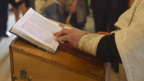 Priest reading the Bible in church Footage