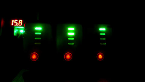 Shimmering traffic lights from the rows of green and red lamps Footage