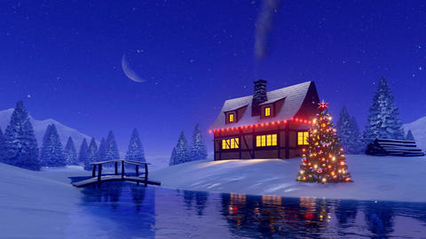 House and fir tree decorated for Christmas at snowy night Footage