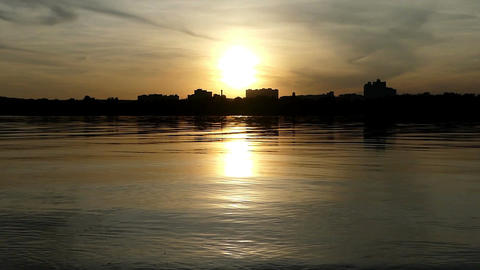 A romantic lake with a sunny path at a nice sunset in summer Stock Video Footage