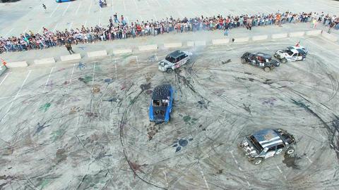Camera Flies above Smashed Autos Driving around Ground Footage