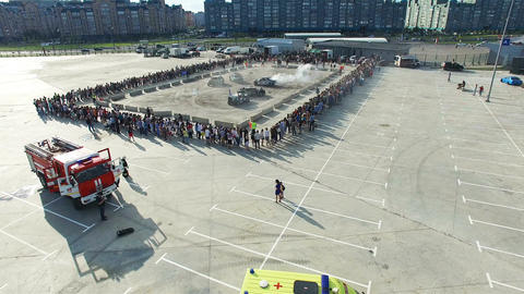 Drone Flies over Square with Extreme Show Rescue Team Footage
