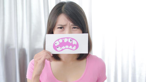 woman with tooth decay problem Live Action
