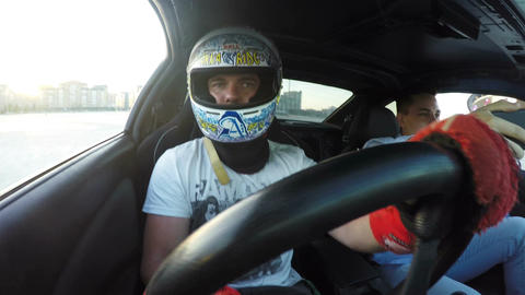 Closeup Racer Drives Sports Car and Guy Makes Selfie Footage