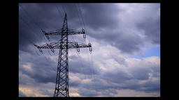 A wire pole under blue white cloud,Strommast Footage