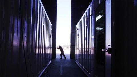 WORKER OPENING WAREHOUSE DOOR