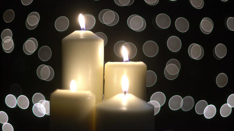 Four white candles light with bokeh Footage