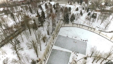 aero view of the city winter park. Skating rink on the frozen lake. Winter Footage