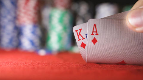 Poker player showing good card combination, Ace and K in slow motion Footage