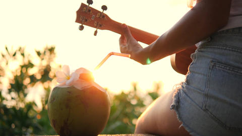 Young Hippie Girl Playing Ukulele Guitar at Beautiful…, Live Action