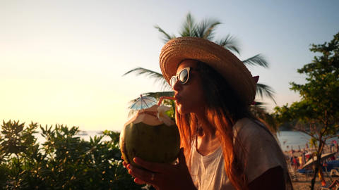 Attractive Young Mixed Race Tourist Girl Drinking Fresh Thai Coconut Water Live Action